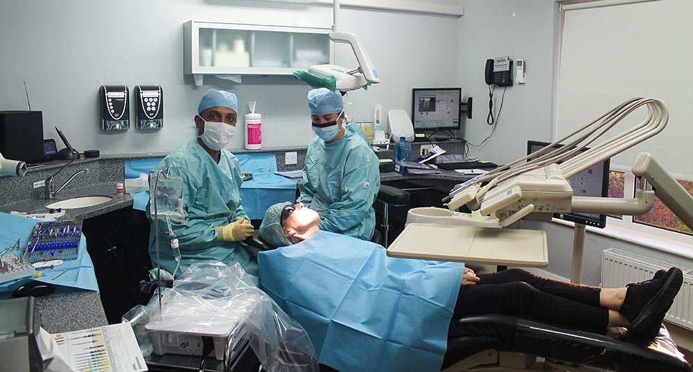 Dentist, nurse and patient prepared for operation