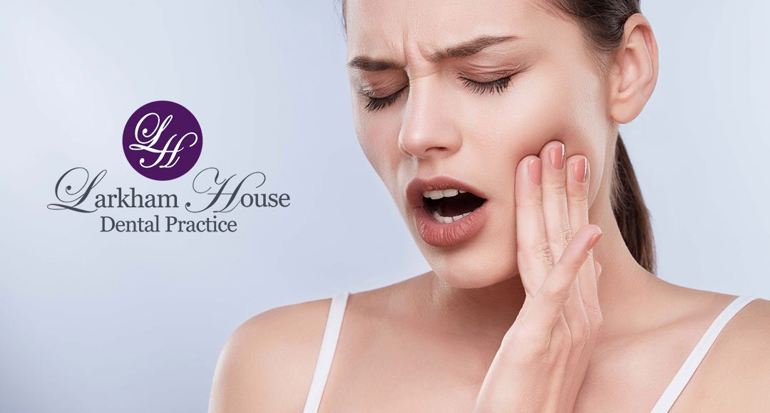 Woman with toothache requiring emergency dental treatment